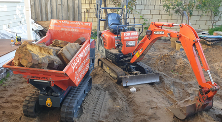 Mini excavator removing broken bricks