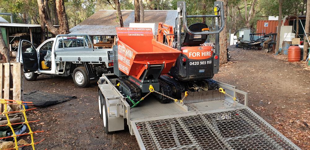 Mini excavatr and dumper in the bush
